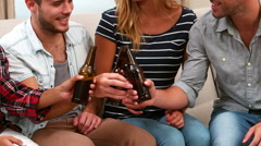Smiling friends drinking beer together Stock Footage