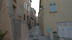 Narrow street with old buildings in Saint-Tropez Stock Footage