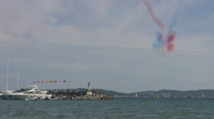 Stock Video Footage of French flag smoke trails left behind on Sainte-Maxime's cloudy sky, France