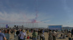 Tourists standing on the beach and watching the air show in Sainte-Maxime Stock Footage