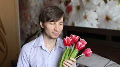 Attractive man sends a kiss and gives flowers. Stock Footage
