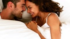 Happy couple having fun in the bed at home Stock Footage