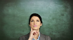 Thoughtful businesswoman looking up Stock Footage