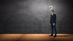 Businessman standing against question marks and bulb - stock footage