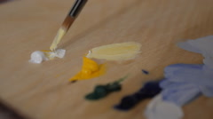 Mixing paints on the palette  Stock Footage