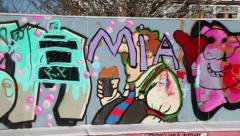 Swedish graffiti painted on a wall in a graffiti park Stock Footage
