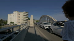 Walking and driving on Sainte-Maxime Bridge, France Stock Footage