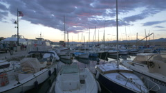 Great view of sailboats moored in Port de Saint Tropez at dusk Stock Footage