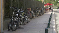 Bikes leaning against a fence, on a street in Saint-Tropez Stock Footage