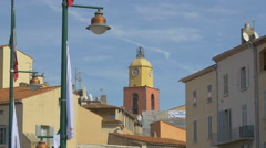 Church of Our Lady of the Assumption's tower seen from the port of Saint-Tropez Stock Footage