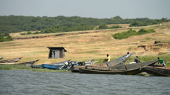 fishing boats on the bank of the Kazinga chanel, Queen Elizabeth National Park, - stock footage