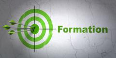 Stock Illustration of Studying concept: target and Formation on wall background