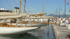 Walking next to beautiful sailboats anchored in Port de Saint Tropez - stock footage