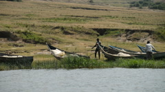 Fishing boats on the bank of the Kazinga chanel, Queen Elizabeth National Park, Stock Footage