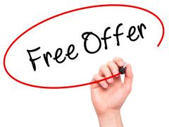 Man Hand writing Free Offer  with black marker on visual screen Stock Photos