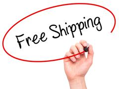 Man Hand writing Free Shipping with black marker on visual screen Stock Photos