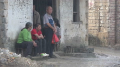 Villagers take shelter from the heavy rain downpour in China - stock footage