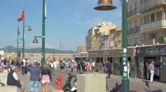 People walking on a sunny day on Quai Jean Jaurès, in Saint-Tropez Stock Footage