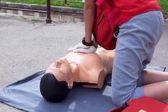 First aid. cardiac massage. Stock Photos