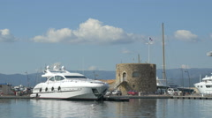 Yacht anchored near a stone building in Saint Tropez - stock footage