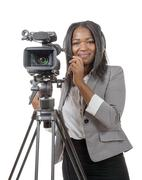 young African American women with professional video camera and headphone - stock photo