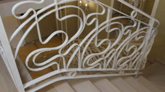 The staircase with wrought iron railing. Stock Footage