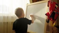 Boy Erasing Written from the Marker Board Stock Footage
