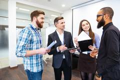 Group of confident business people on meeting with team leader Stock Photos