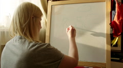 Woman Drawing Happy Family on Marker Board Stock Footage