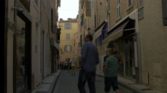 Tilt up view of people walking on Rue Général Allard, in Saint-Tropez Stock Footage