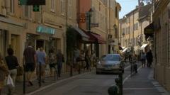 Tourists and locals walking on General Allard street, in Saint-Tropez Stock Footage