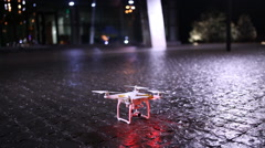 Night Scene of the city with quadrocopters Stock Footage