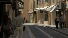 People walking on Rue Général Allard, in Saint-Tropez Stock Footage