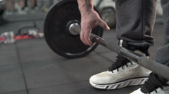 Slowly demonstration of deadlift of strong man with with distinct veins on arms - stock footage