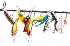 colored fishing bait wobblers be suspended on rod`s blank - stock photo