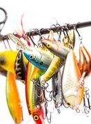 Colored fishing bait wobblers be suspended on rod`s blank Stock Photos