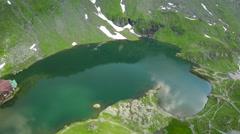 Balea Lake, Transfagarasan, Romania, aerial Stock Footage