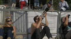Young man taking pictures with a professional camera in Sainte-Maxime, France Stock Footage