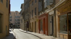 Couple with a baby stroller walking on Rue Henri Seillon, in Saint-Tropez Stock Footage