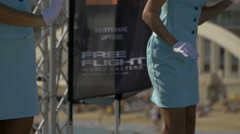 Women in blue clothes dancing and smiling in the port of Sainte-Maxime, France - stock footage