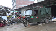 China backstreets, old transport vehicle, recycling shop, pile of scrap metal Stock Footage