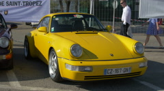 A yellow Porsche Coupé Classic in Saint-Tropez Stock Footage