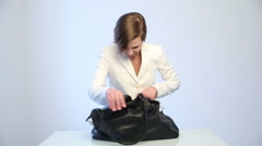 Girl searching for a phone in his bag Stock Footage
