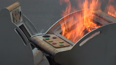 Closeup of old gaming machines on fire, environment, toxic material, China Stock Footage