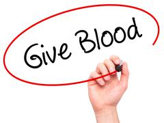 Man Hand writing Give Blood  with black marker on visual screen Stock Photos