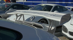 Porsche inscription on the rear wings of a sport car in Saint-Tropez Stock Footage