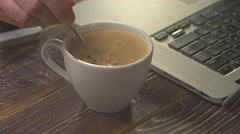 Coffee cup with smart phone and laptop Stock Footage