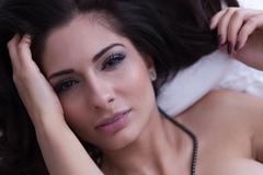 Boudoir portraiture with sexy brunette posing - stock photo