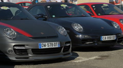 Tourists admiring the luxurious Porsche cars at an auto show in Saint-Tropez Stock Footage