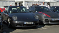 Luxurious Porsche cars displayed at an auto show in Saint-Tropez Stock Footage
